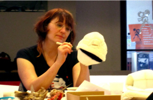 The author Chrystene Ells working on the head of a Parathyroid Punk character.